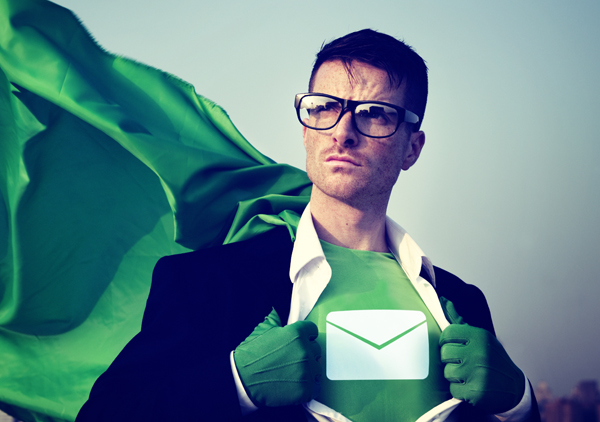 Super hero breaking out of business attire with envelope on shirt underneath