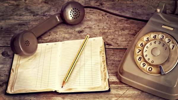 Rotary phone and message book