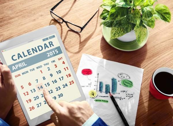 man's hand touching a calendar on an ipad