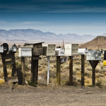 vintage mailboxes representing email with mountains in the background