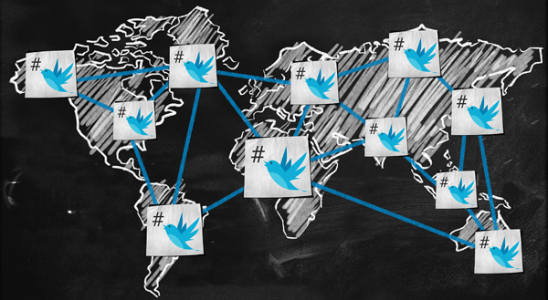 Map of the world in chalk with twitter birds and hashtags
